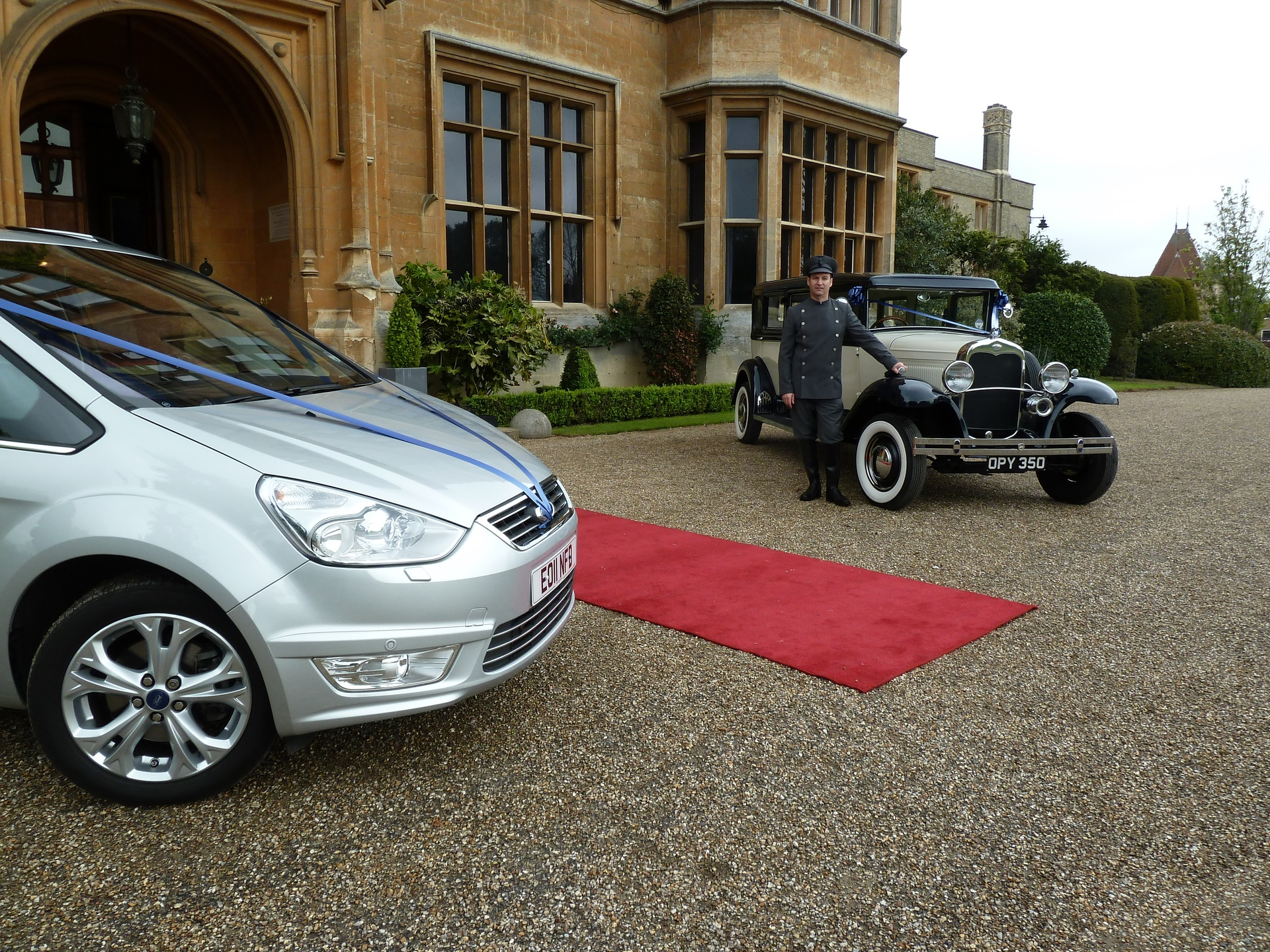 Chauffeur with both cars at Shuttleworth